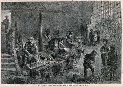 Image from object titled Men and boys are working in a fork-grinders. Wood engraving by J. Palmer.