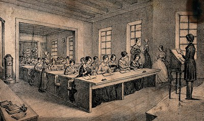 Image from object titled A classroom with children sitting at long tables and a teacher standing with a book in her hand. Lithograph by J.B. Sonde.