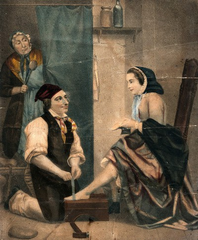 Image from object titled A young woman is sitting on a chair holding a shoe in her hand as she has her feet measured by a man in an apron, they are being watched by a woman in the background who is holding a large spoon. Colour lithograph.