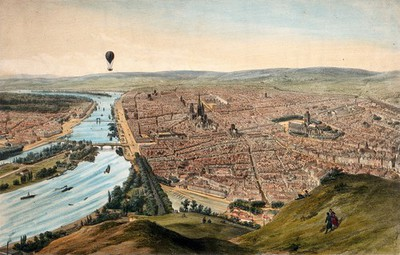 Image from object titled A hot-air balloon travels over Rouen, giving an aerial view. Coloured lithograph by J. Arnout after himself.