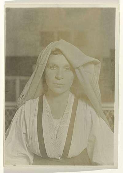 Image from object titled Portret van een vrouw met doek over het hoofd; Immigrant woman on Ellis Island, 1905-1906 Albanian Woman, Ellis Island