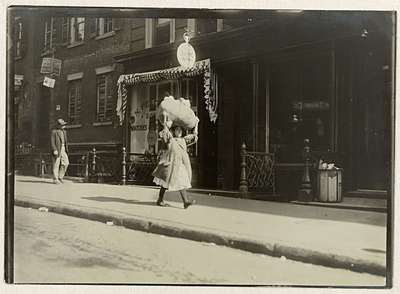 Image from object titled Girl Carrying Homework thro Greenwich Village