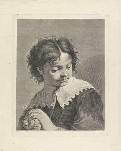 Jongen met bal in zijn handen