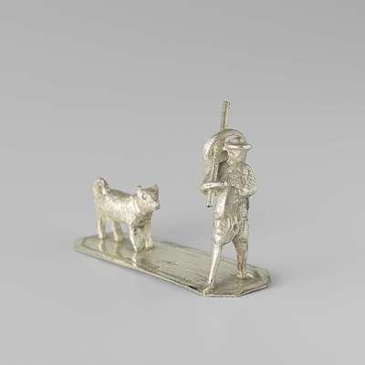 Image from object titled Man met hond en stok