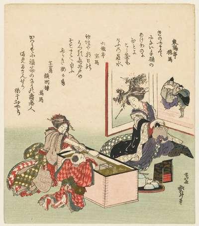 Twee vrouwen en een jongetje bij komfoor