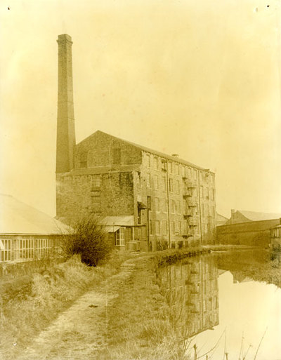 Brunswick Mill (Swizzels-Matlows) before extension, and the Peak Forest Canal viewed from the west.