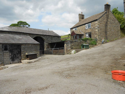 Hill Farm, Chinley. Mr Cooper in yard. Looking SE from SK026831.