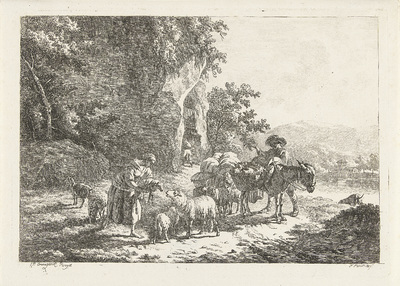 Herders met kudde nabij grot
