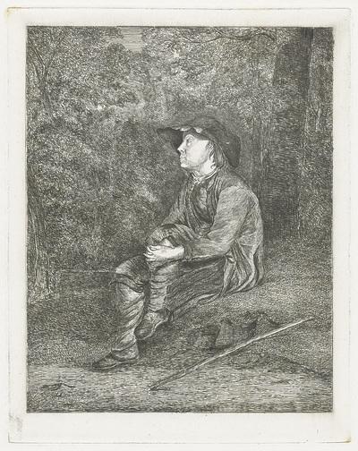 Zittend jongetje in het bos