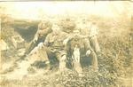 Foto van een zittende groep Belgische soldaten.