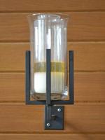 Wandkandelaar met godslamp
