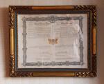 Oorkonde met vaststelling en toestemming van het gemeentelijk wapenschild van Dilbeek