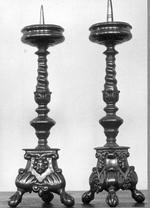 4 kandelaars van patatineerd brons.