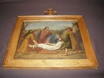 14de statie kruisweg: Jezus wordt in het graf gelegd