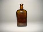 Vierkante bitterfles in bruin glas, ca. 1900-1950