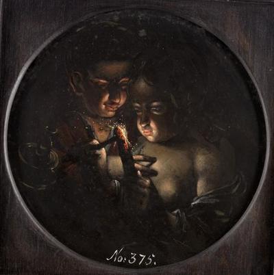 Knabe und Mädchen, eine Kerze anzündend