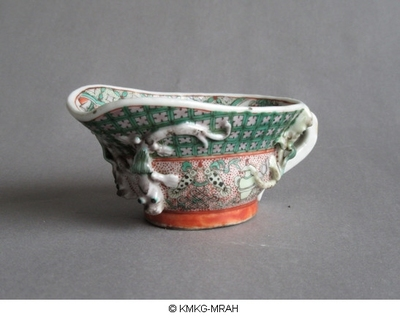Libation cup with crawling dragons in high relief