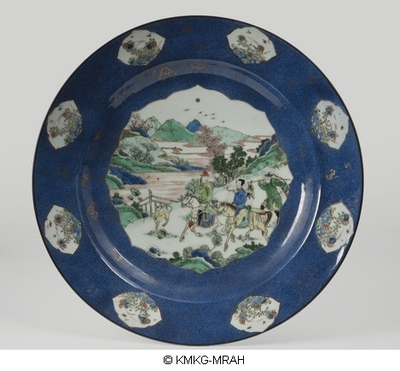 Charger decorated in powderblue with reserved pannels decorated in famille verte