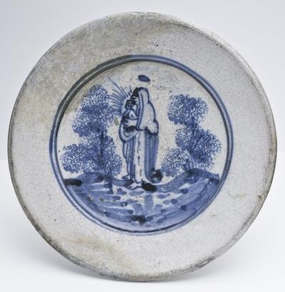 Faience schotel met binnen dubbele concentrische cirkel Maria met Christuskind