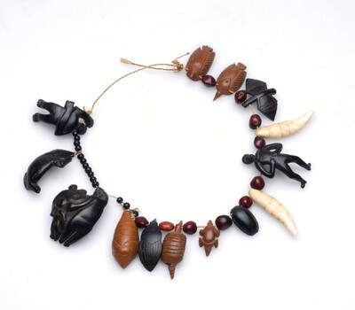 Necklace made of seeds and decorated with amulet figurines
