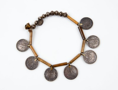 Necklace with attached silver coins