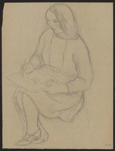 Kobieta rysująca na papierze, na kolanach