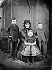 woman and three children]
