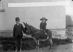 boy riding a donkey, Pembroke]