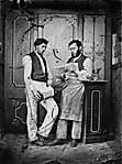 [Two men, one playing the concertina and the other singing]