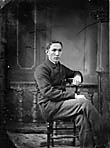 young man sitting]
