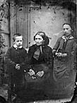 woman with a girl and a boy]