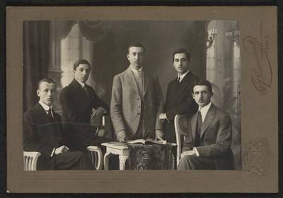 Group portrait of five men in urban clothes
