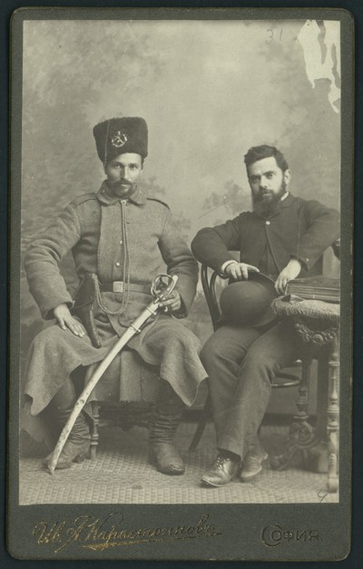 Studio portrait of Ivan Karastoyanov and policeman Georgi