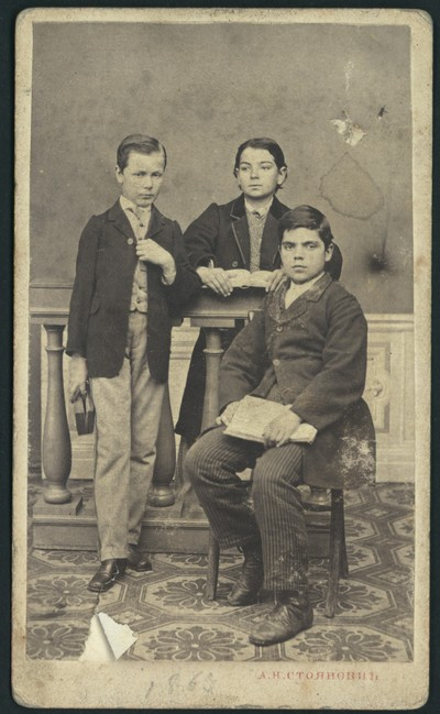 Studio portrait of three students