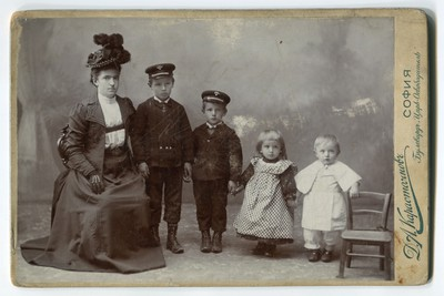 Studio portrait of a mother with four children