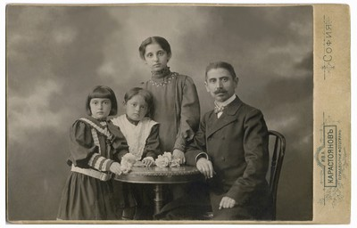 Studio portrait of Andrey Dimitrov with his three daughters