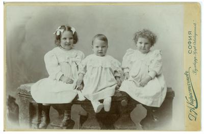 Studio portrait of the Kalchevi siblings