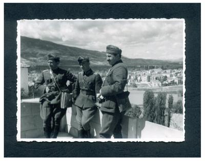 Three men in military uniforms