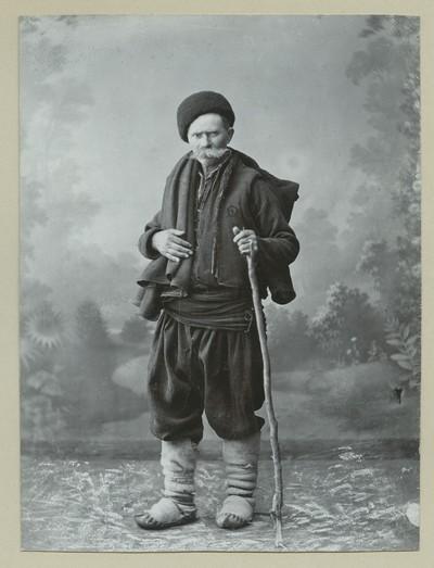 Studio portrait of a man in folk attire