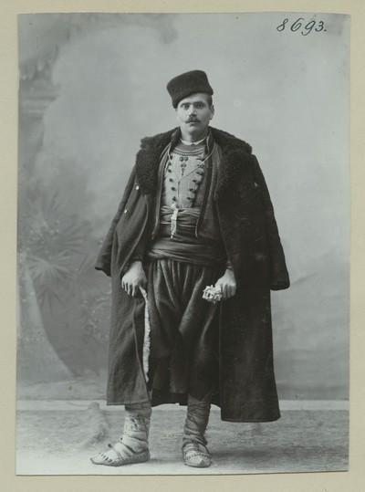 Studio portrait of a man in traditional attire