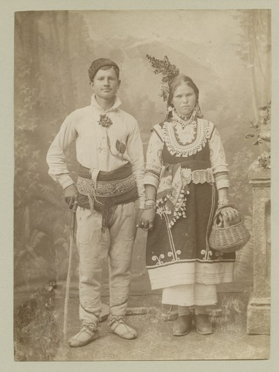 Studio portrait of a woman and a man in folk attire