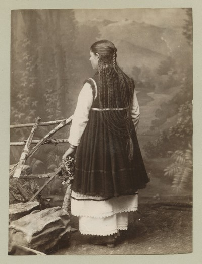 Studio photograph of a woman in back view