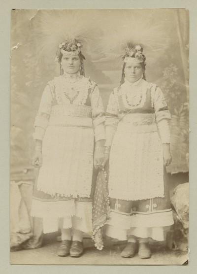 Studio portrait of two women in folk attire