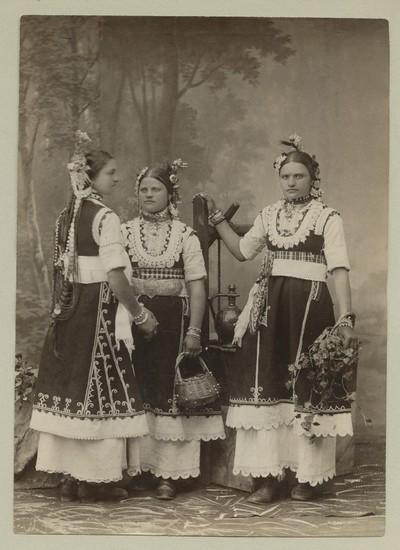 Studio portrait of three women in folk attire