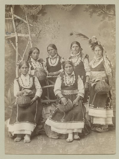 Studio portrait of six young women in folk attire