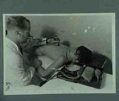 Medical examination of a wounded boy