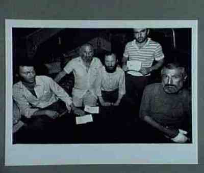 Men showing their new old-fashioned Georgian passports are on hunger-strike against the KGB's activities in Georgia. Series of 2 photos