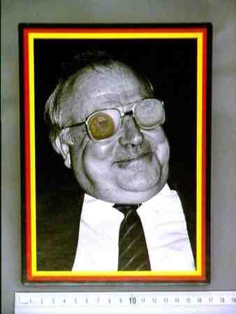 Portrait of Kohl with West en East German coin in his eyes