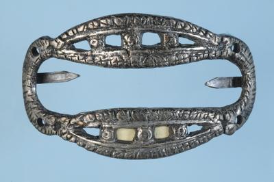 mordants (belt components)