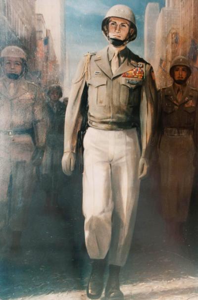 In januari 1946 werd de Amerikaanse 82ste Luchtlanding Divisie geëerd met een 'Victory Day Parade' op de 5th Avenue in New York City in de Verenigde Staten van Amerika. De paradewerd voor een deel geleid en afgenomen door Generaal James M. Gavin. Gavin was de jonge divisiecommandant, die vanaf september 1944 de divisie leidde en het wel en wee van zijn manschappen had gedeeld. In zijn getailleerde uniform maakte hij een onuitwisbare indruk, die treffend op deze foto tot uitdrukking komt.